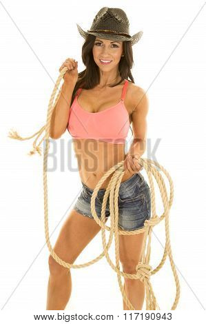 Cowgirl In Denim Shorts And Pink Sports Bra Holding A Rope