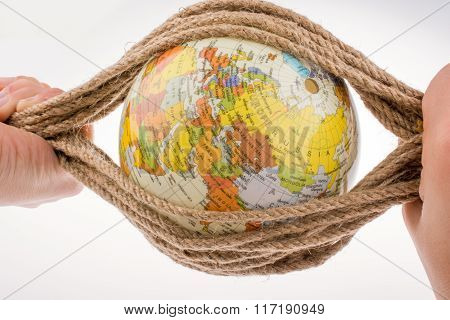 Globe In Hand Wrapped With Rope