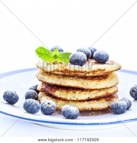 Pile Of Pancakes With Blueberries Sprinkled With Icing Sugar