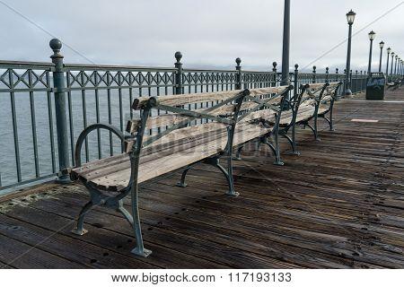 Park Benches Along A Wooden Pier