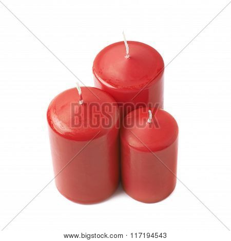 Three red wax candles isolated