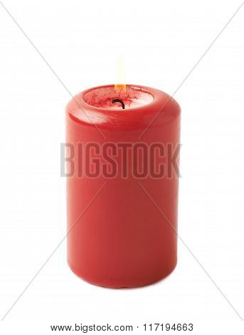 Burning red candle isolated