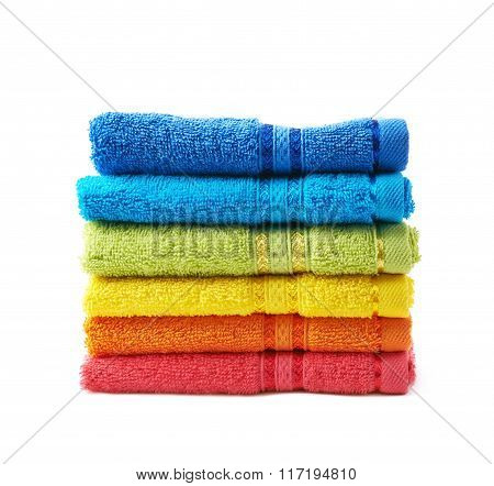 Pile of rainbow colored towels isolated