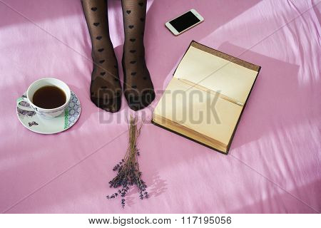 Woman On The Bed With Smartphone, Notebook And Cup Of Coffee