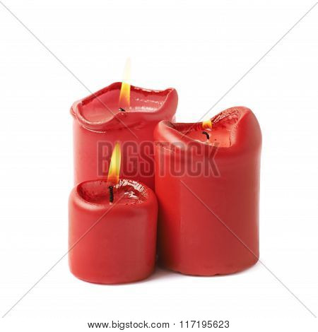 Three burning red candles isolated