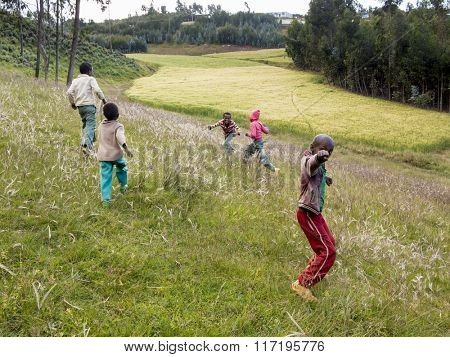 OROMIA, ETHIOPIA-NOVEMBER 5, 2014: Unidentified kids play in a field in Ethiopia.