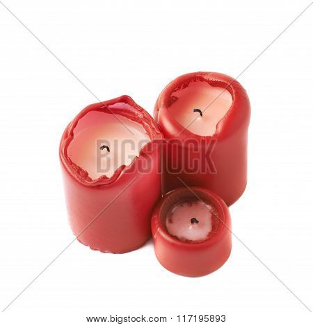 Three red candles isolated