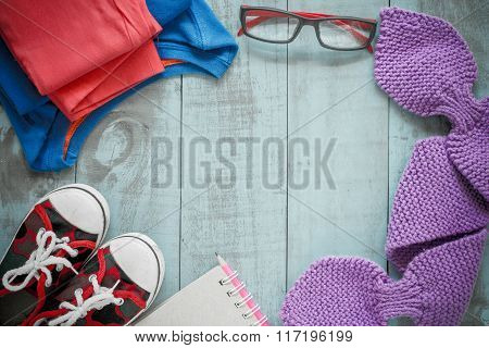 Winter Clothes. Set Of Women's Clothing On A Wooden Background.