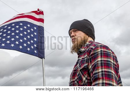 Young Man Holds Upside Down Flag.