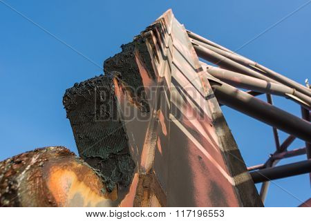 Jack up oil rig leg with blue sky when alomost fully up by motor and grease on it in rig move operation