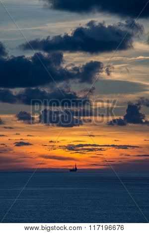 Jack up oil rig in the ocean at twilight time