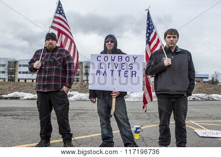 Three Men With Flags And Signs.