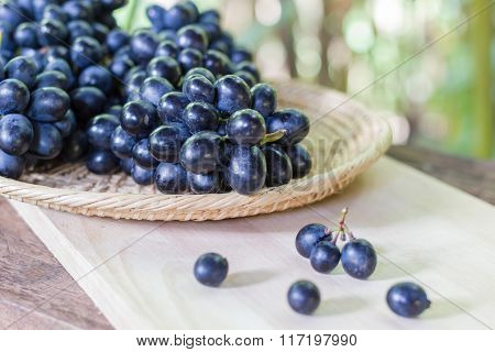 Black Grapes On Wooden