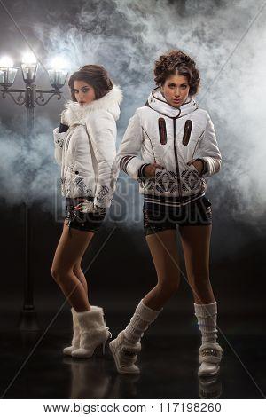 Two Young Beautiful Women In Fashionable Clothing