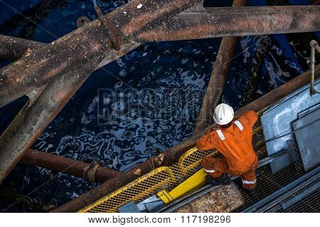 Worker at jack up oil rig leg when checking everything in rig move operation
