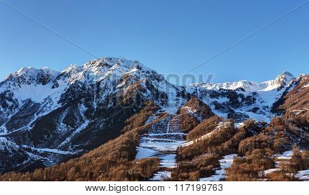 Mountains With Trees On The Slopes