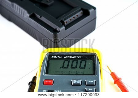 Digital meter on white background.