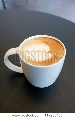 Top View Of White Mug Cup Containing Hot Cappuccino Coffee
