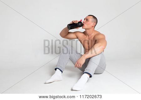 Athlete drinking from a shaker