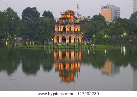 View of the temple of the turtles in the early evening twilight. Vietnam