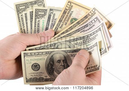 Dollars In A Man's Hand Isolated On White