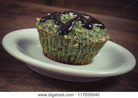 Vintage Photo, Fresh Muffin With Spinach, Desiccated Coconut And Chocolate Glaze, Delicious Healthy
