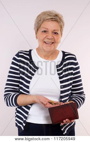 Happy Senior Female Holding Coins And Leather Wallet, Concept Of Financial Security In Old Age