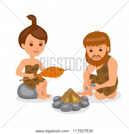 Caveman. Male kindles fire. Female cook the fish on the fire. Isolated character prehistoric people