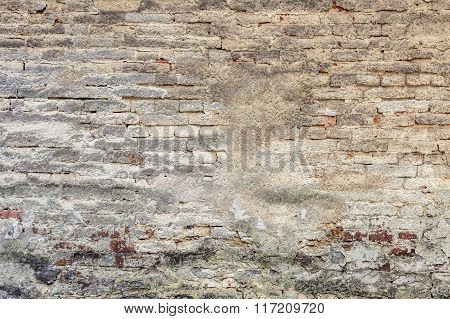 Old plaster on brick wall