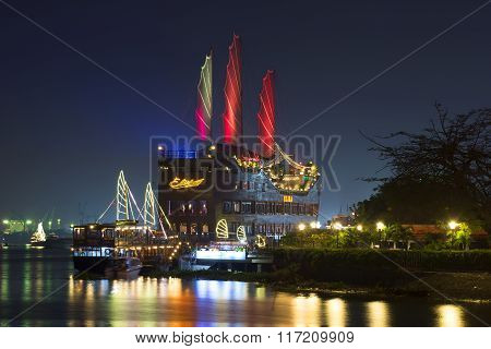 Scarlet sails over Saigon. Sightseeing sailing ship restaurant. Vietnam