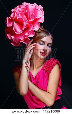 Girl with big pink flower on head