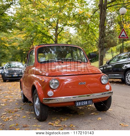 Florence, Italy - September 17, 2015: Classic Fiat 500 on the street of autumn Florence, Italy