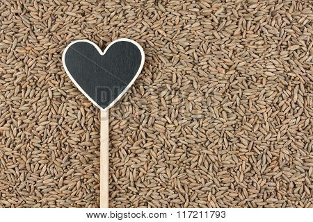 Pointer In The Form Of Heart Lies On Rye Grains