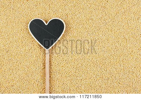 Pointer In The Form Of Heart Lies On Millet Grains