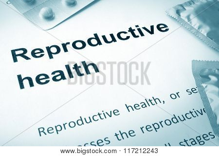 Paper with words reproductive health.
