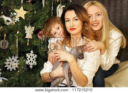 Beautiful Family Near Christmas Tree