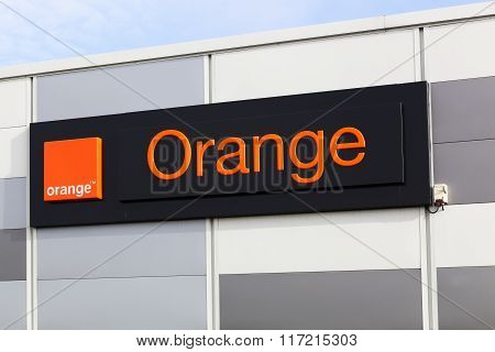 Orange logo on a facade