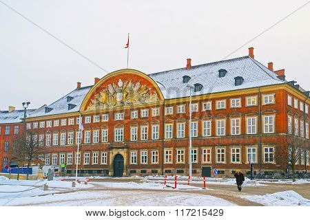 COPENHAGEN DENMARK - JANUARY 5 2011: Ministry of Finance building in Copenhagen Denmark in winter. It is placed in Christiansborg Slotsplads. It is known as Red Mansion and the Chancery Building