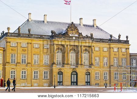 COPENHAGEN DENMARK - JANUARY 5 2011: Frederick Eighth Palace in Amalienborg in winter. Amalienborg is a Royal Palace in Copenhagen Denmark. It consists of four identical palaces around a courtyard