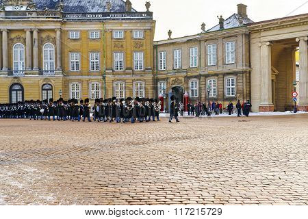 COPENHAGEN, DENMARK - JANUARY 5, 2011: Guard change in Amalienborg in winter. Amalienborg is a Royal Palace of Copenhagen Denmark. It consists of four identical classical palaces around the courtyard.
