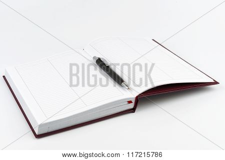 Black Ballpoint Pen In The Center Of An Open Diary
