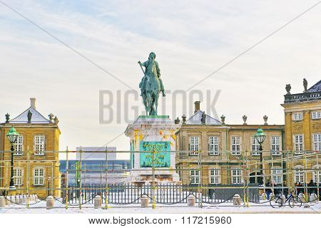 COPENHAGEN DENMARK - JANUARY 5 2011: Statue of Frederik Fifth on Horseback in Amalienborg in winter. A statue of its founder King Frederick Fifth is in the center of the square