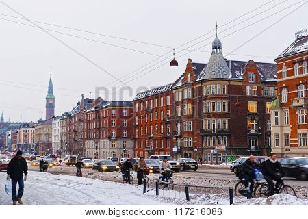 COPENHAGEN DENMARK - JANUARY 5 2011: Street view to Copenhagen City Hall Tower in winter. It is the headquarters of the municipal council. The building is situated in central Copenhagen Denmark