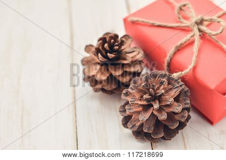 Close Up Of Pine Cone And Red Box Gift
