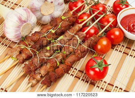 Pork Skewers With Cherry Tomatoes And Garlic