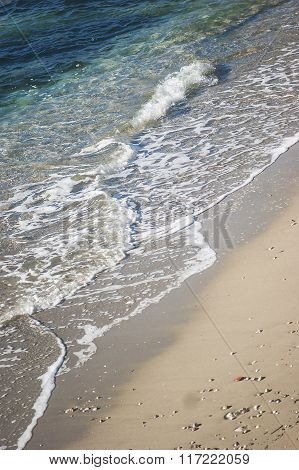 The waves on a sandy beach