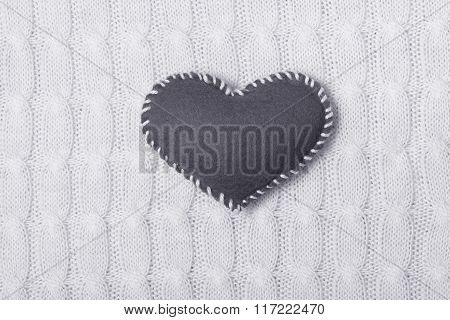 Textile  heart on white knitted texture