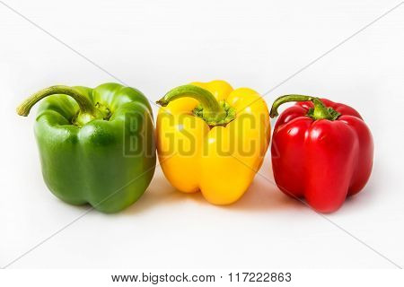 Fresh peppers. Three sweet Red Yellow Green Peppers isolated on white background.
