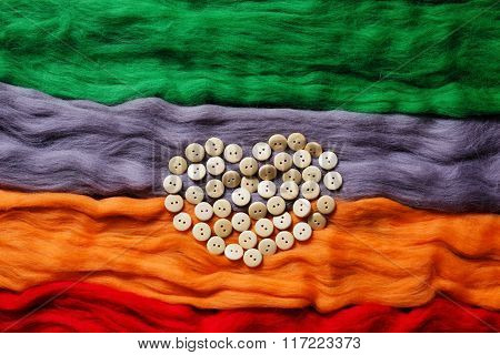 Background From Coloures Wool And Buttons
