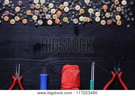 Tools for needlework: buttons, thread, needles, crochet hooks and pliers